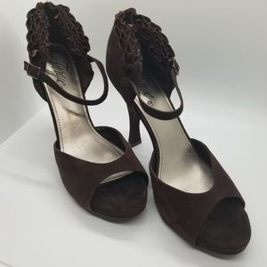 Fergie suede peep hole shoes.